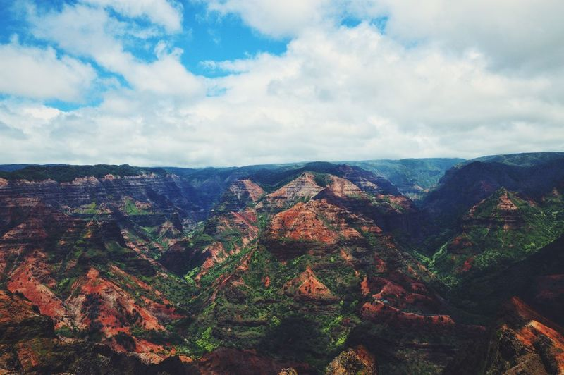 Scenic view of mountains at waimea canyon state park against sky