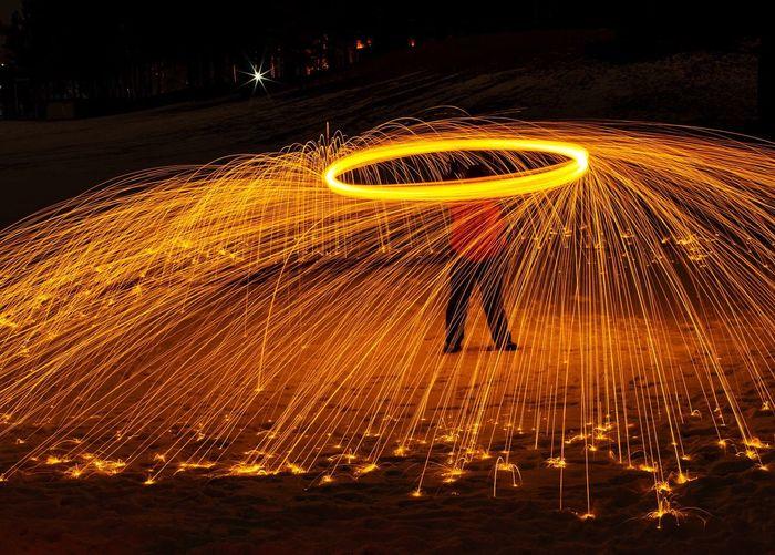 Person Standing With Light Painting At Night