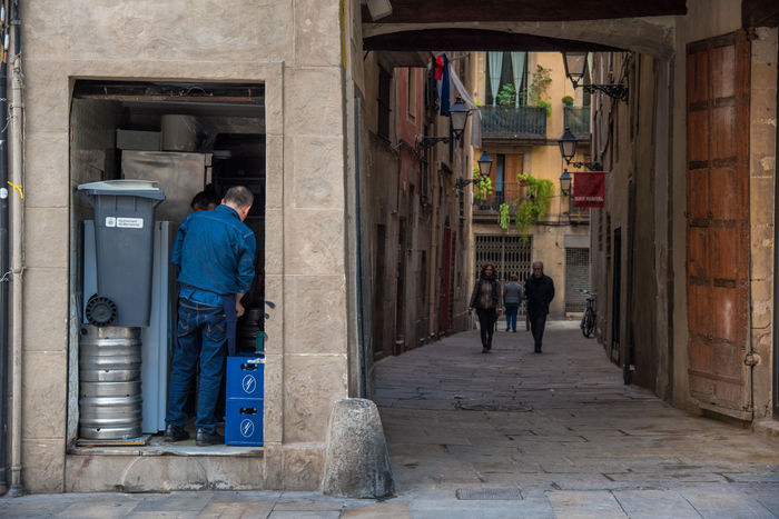 Architecture Barcelona Doors Perspective Perspectives Workers Architecture Building Exterior Built Structure Close Door Doorway El Born Full Length House Lifestyles Medieval Men Open Outdoors Real People Residential Building Street Streetphotography Urban