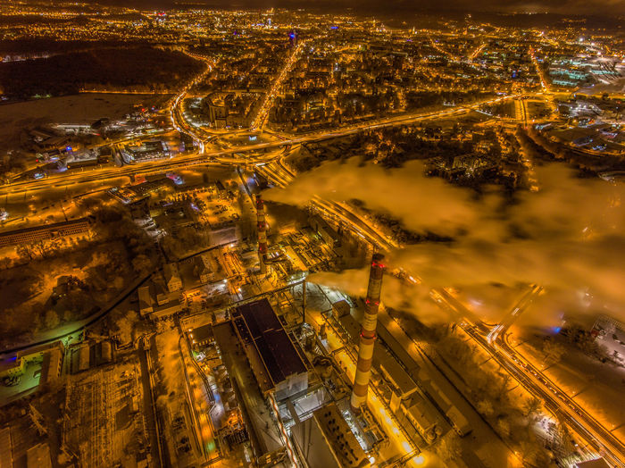 smoke rising from central heating station in early morning of winter in Vilnius, Lithuania. Captured with DJI phantom Baltic Chimney Cityscape Drone  Smoke Smoke Stack Steam Street Light Vilnius Aerial View Architecture Areal View Built Structure Enviormental Issues Heating Station Illuminated Long Exposure Motion Night Outdoors Pollution Power Station Snow Ussr
