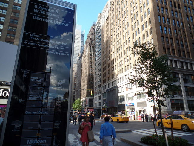 8 Avenue Architecture Building Building Exterior Built Structure City City Life City Street Day Garment District Glass Reflection Leisure Activity Lifestyles Modern New York City Office Building Outdoors Sky Stree Photography Tall - High Taxi Yellow