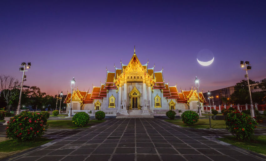 Marble temple with smiling moon Watbenchamabophit Architecture Belief Building Building Exterior Built Structure Clear Sky Half Moon History Illuminated Marble Temple Moon Nature Night No People Outdoors Place Of Worship Religion Sky Smiling Moon Spire  Spirituality The Past Travel Travel Destinations