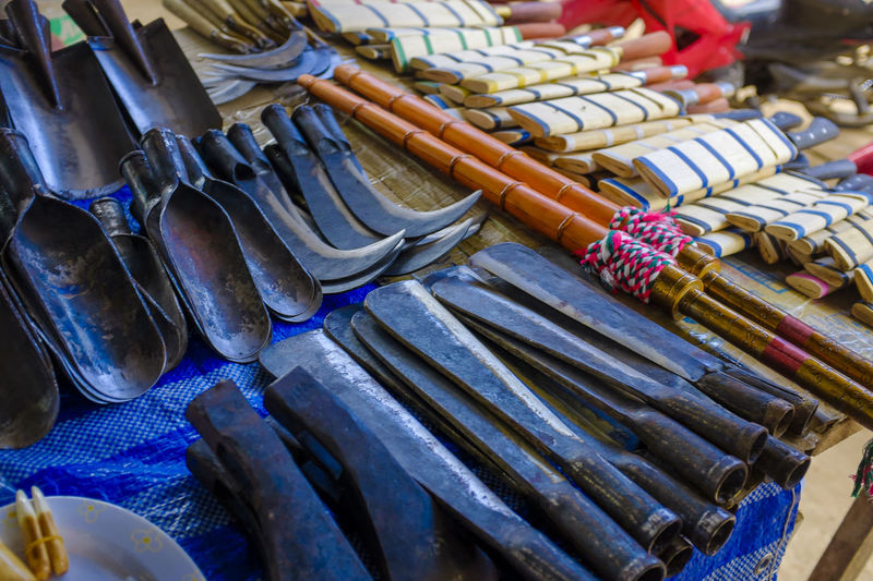 Close-up of local knives for sale in market