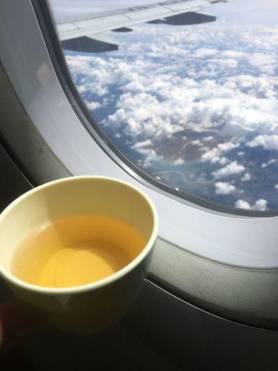 Herbal tea by airplane window