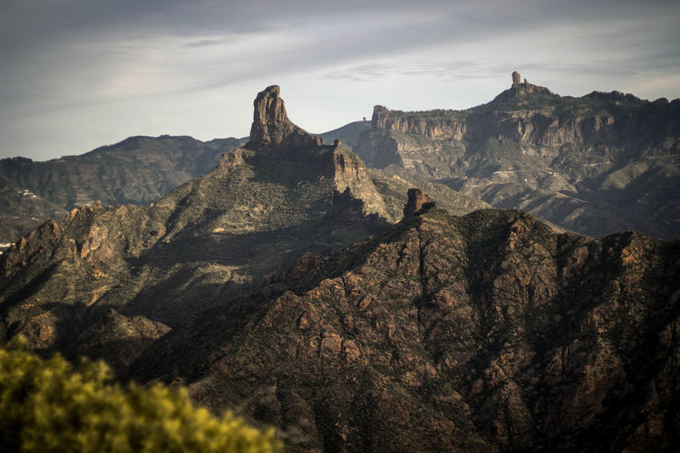 Behind the air Mountain Mountain Range Scenics - Nature Beauty In Nature Sky Environment Nature Tranquil Scene Landscape Adventure Rock Tranquility Non-urban Scene Cloud - Sky Day Leisure Activity Land Plant Hiking Rock - Object Outdoors Mountain Peak Roque Nublo Gran Canaria Islas Canarias
