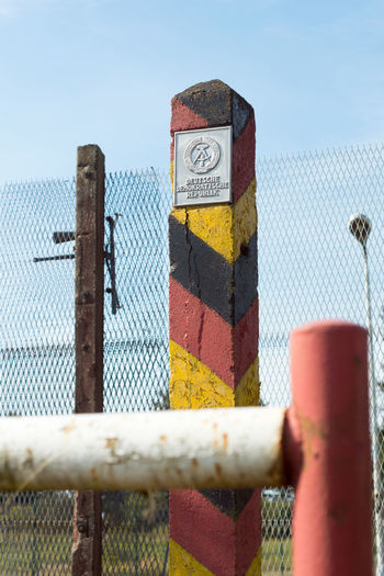 Border Chainlink Fence Change Clear Sky Close-up Communist Day DDR East Germany Fence GDR Germany Low Angle View Metal No People Outdoors Prison Protection Rusty Safety Sky The Wall Wall Warning Sign Wende