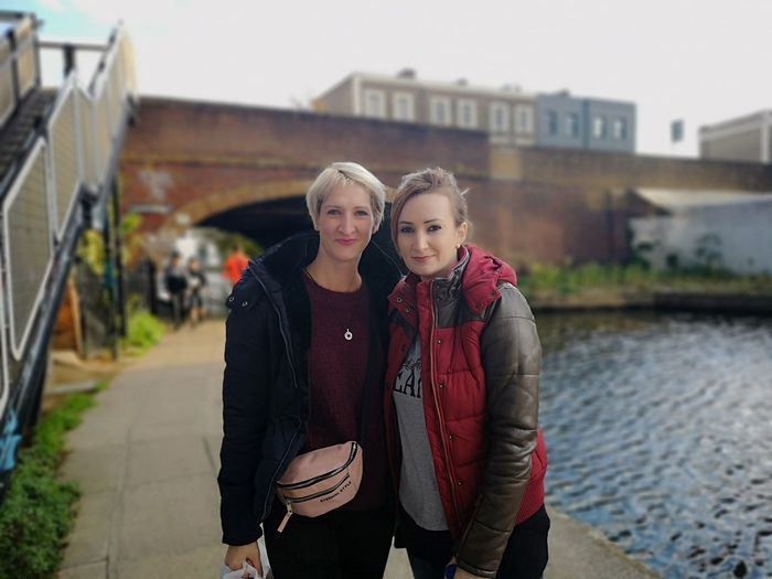 City Friendship Blond Hair Young Women Portrait Togetherness Bonding Standing Front View Arm In Arm