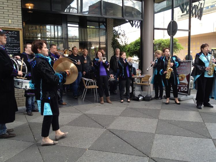 Throwback Eindhoven May 2012 Brass Band City Life Cobblestone Friendship Full Length Lifestyles Men Occupation Pattern Pavement Paving Stone Real People Showcase: February Sidewalk Standing Street Street Performance Street Performer Streetphotography The Tourist Tiled Floor Togetherness Walking Women