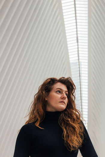 One Person Beautiful Woman The Oculus World Trade Center Red Hair Millenials Turtle Neck Portrait Indoors  Young Professional Day Dreaming Thinking