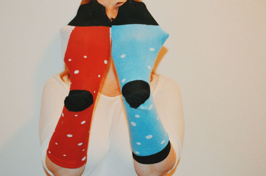 Human Body Part Lifestyles Footwear Wearing Socks Contrasting Colors Colourful Dots Sock Still Life White Background Multi Colored Fashion Close-up Female Likeness Human Representation Moments Of Happiness