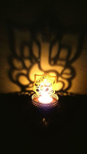 Glowing Illuminated Heat - Temperature No People Flame Close-up Night Burning Indoors  Filament Technology Diwali Celebration Festive Feels Reflection Shadow Lord Ganesh🙏😀 Worship Time Deep Thoughts