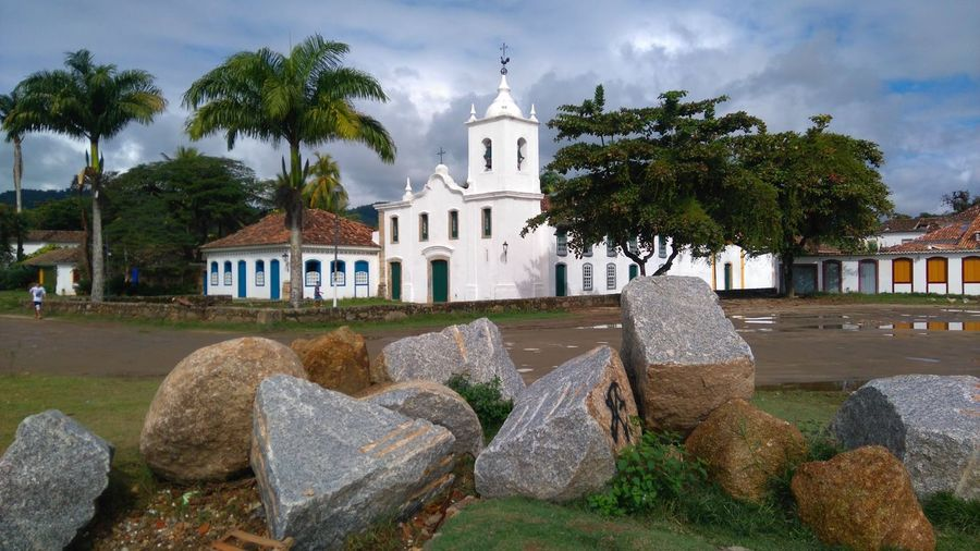 Paraty - RJ Brasil Tree Place Of Worship Religion City Sky Architecture Building Exterior Cloud - Sky Built Structure Tombstone Graveyard Memorial Death Cemetery Bell Tower - Tower Statue Monument The End Gravestone Grave Place Of Burial Tomb Sculpture Cross Mausoleum The Great Outdoors - 2018 EyeEm Awards