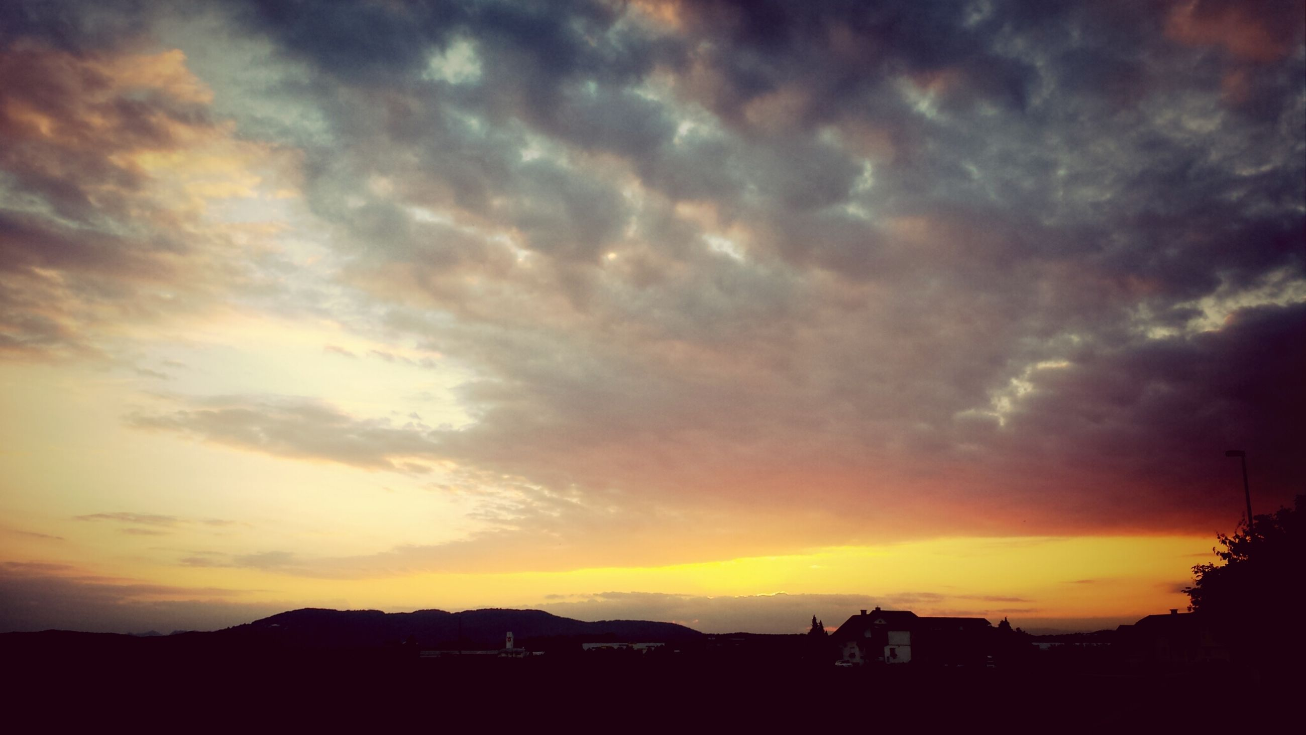 sunset, silhouette, sky, cloud - sky, orange color, beauty in nature, scenics, building exterior, dramatic sky, built structure, cloudy, architecture, tranquil scene, tranquility, nature, cloud, idyllic, moody sky, weather, house