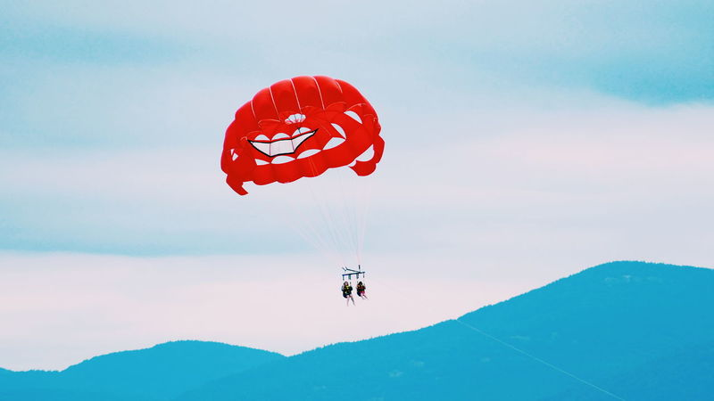 Red RISK Adventure Mid-air People Full Length Extreme Sports Flying Day Sky Outdoors Parachute Adult Adults Only Travel Destinations Lakeview Lake Adirondack Adirondacks Adirondack Mountains New York NY Arts Culture And Entertainment Beauty In Nature Motion