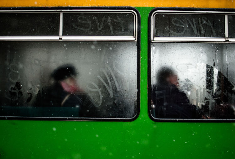 View of commuters through train window