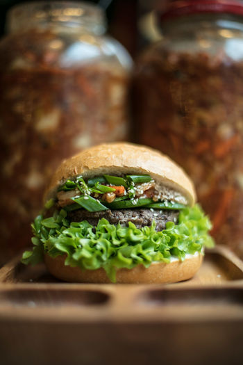 Arugula Bread Bun Canonphotography Close-up Day Dine Eat Fast Food Food Food And Drink Food And Drink Freshness Hamburger Hospitality Indoors  Lettuce Light And Shadow No People Ready-to-eat Restaurant Sandwich The Week Of Eyeem Tomato Vegetable