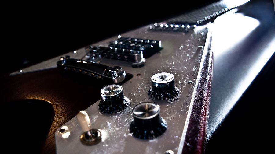 Close-up of electric guitar volume knobs