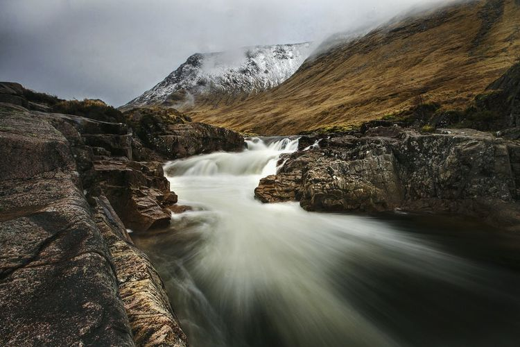 The river was flowing fast and fierce and had to be tamed through my lense. This was captured by me in glencoe Scotland. Stunning locations and scenery Scenics Nature Beauty In Nature Water Landscape Mountain Sky Landscape_photography Water_collection Landscape_captures Photooftheday Landscapes EyeEm Best Shots EyeEmBestPics EyeEm Best Shots - Landscape EyeEm Nature Lover River Riverscape Rock Formation Low Angle View Landscape_Collection Long Exposure Photography No People Vacations Glenetive