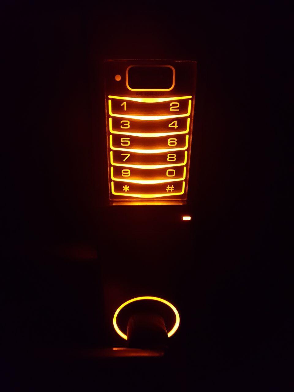 CLOSE-UP OF ILLUMINATED ELECTRIC LIGHT BULB
