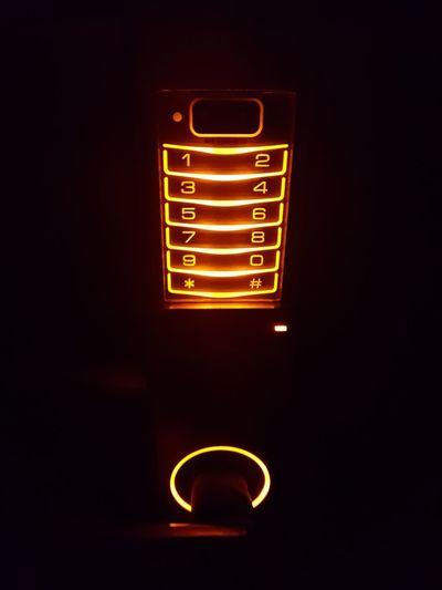 Close-up of illuminated electric lamp in dark room