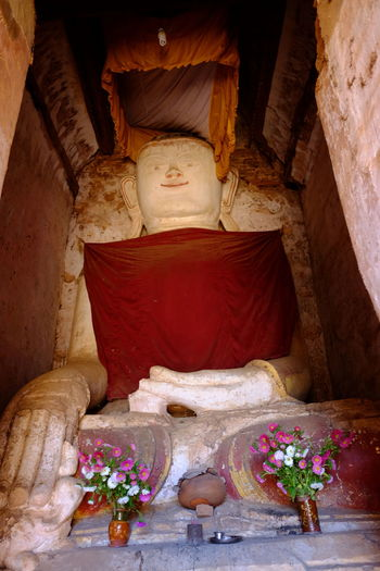 Buddha inside Ancient Stupa (one of 2,257 stupas on this site 11th to 13th century) Ancient Ruins Ancient Stupa Buddha Buddha Statue Buddhist Culture Buddhist Stupa Composition Flowers Full Frame Human Representation Inle Lake Kakku Light And Shade Myanmar No People Old Ruin Outdoor Photography Place Of Prayer Place Of Worship Religion Shan State Stupa Tourism Tourist Attraction  Tourist Destination