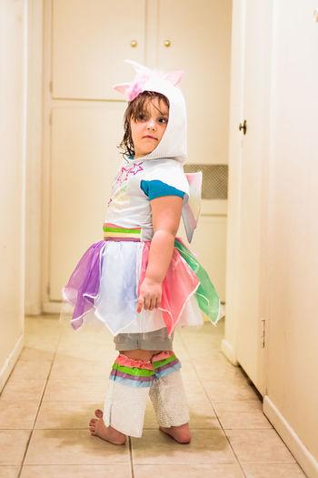 Full length of girl wearing costume standing in corridor