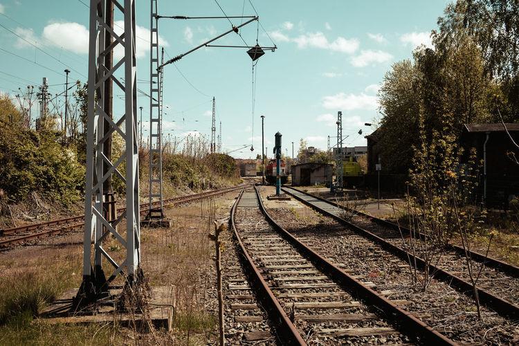 Railway tracks against sky