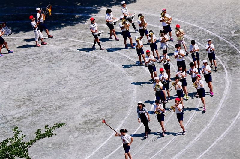 High Angle View Of High School Marching Band On Track