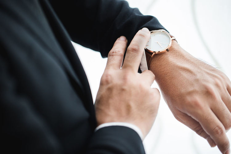 Business investment concept Adult Body Part Bridegroom Close-up Hand Holding Human Body Part Human Hand Indoors  Jewelry Love Males  Married Men Midsection People Real People Ring Suit Two People Wedding Ceremony