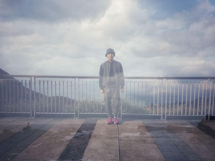 Double exposure of man standing at observation point