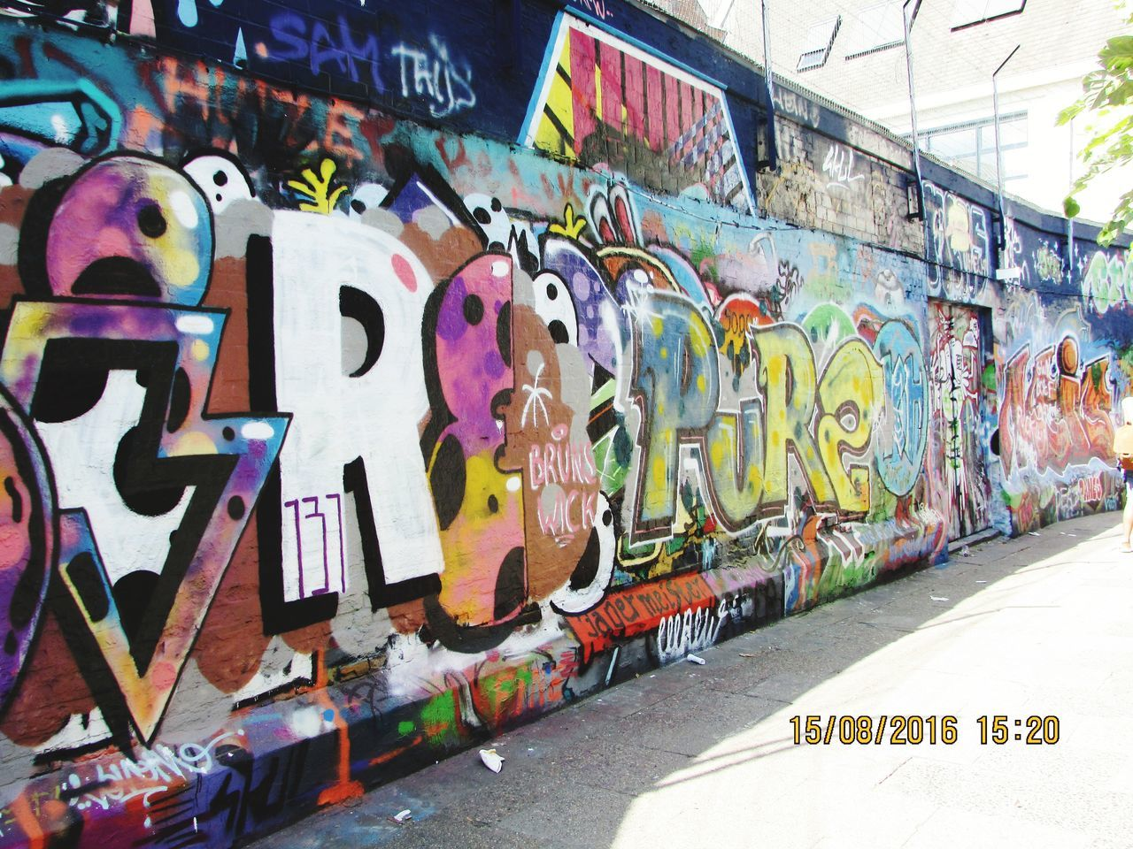 graffiti, text, western script, street art, multi colored, communication, day, built structure, no people, outdoors, architecture