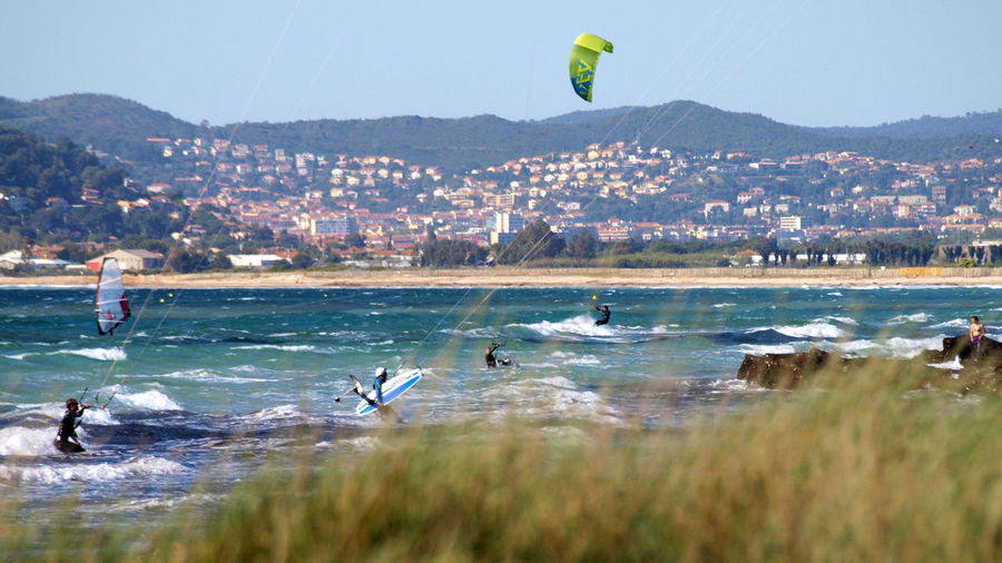 Flying Mid-air Beach Water Vacations Bird Sea Outdoors Large Group Of People Le Var Hyères Les Palmiers Jumping Nature Extreme Sports Parachute Paragliding Mammal People Day Sky Wave Adult Windsurfing Kitsurfing