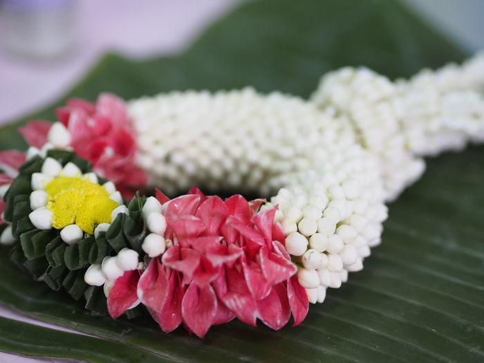 Close-up Of Floral Garland On Banana Leaf