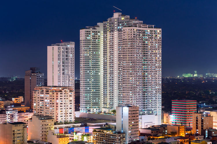Residential condominium in Manila Manila Manila, Philippines Philippines Apartment Architecture Building Building Exterior Built Structure City City Life Cityscape Condominium Financial District  Illuminated Luxury Night Outdoors Residential District Skyscraper Tall - High Tower