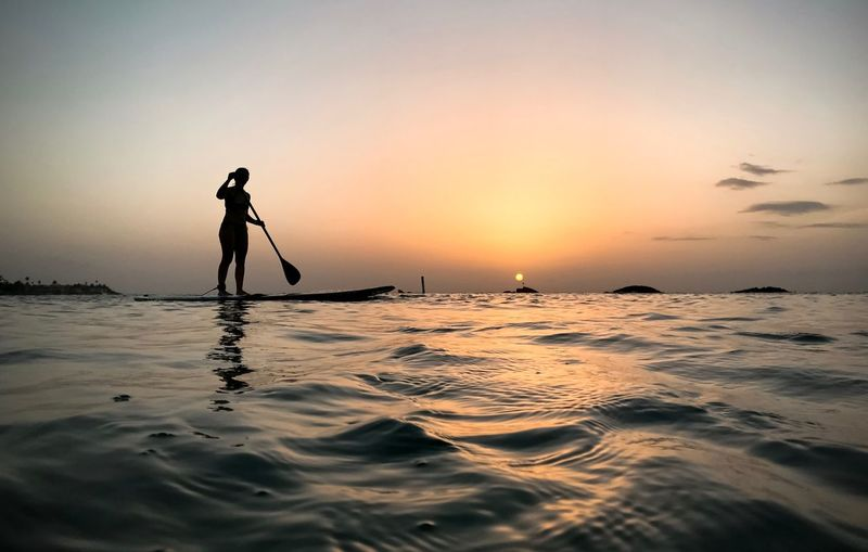 Paddleboarding Sunset Water Sea Sunset Sky Silhouette Waterfront Beauty In Nature Scenics - Nature Orange Color Real People Lifestyles Horizon Horizon Over Water Outdoors Nature The Mobile Photographer - 2019 EyeEm Awards The Great Outdoors - 2019 EyeEm Awards