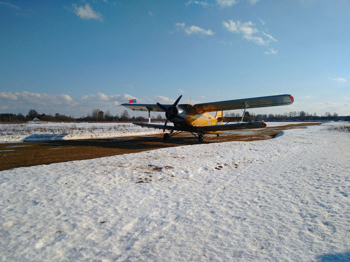 View of airport runway against sky during winter