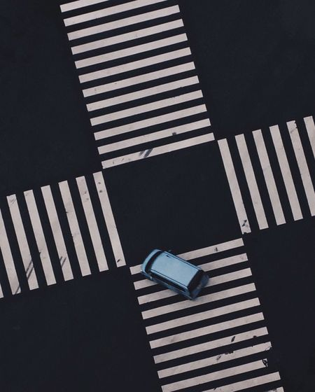 High Angle View Of Car On Zebra Crossing