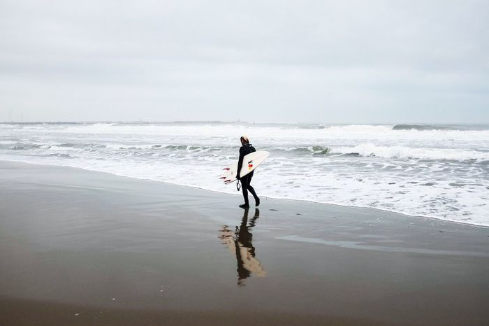 Winter surfer Surf's Up Surfer Sport Beach Sand Cloudy Badweather Lonely Viareggio Lucca Tirreno Sea Seawinter Tuscany Winter Outdoor Surfing Surfingphotography Rain Relax Water Versilia  Silhouette Silhouette Seascape