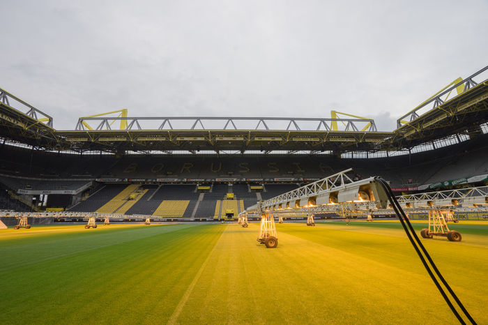 Architecture Borussia Dortmund Bundesliga Care Chair Chairs Cloud Cloud - Sky Clouds And Sky Cloudy Day Dortmund Field Football Football Field Football Stadium Grass Green Light No People Outdoors Soccer Sport Stadium Yellow
