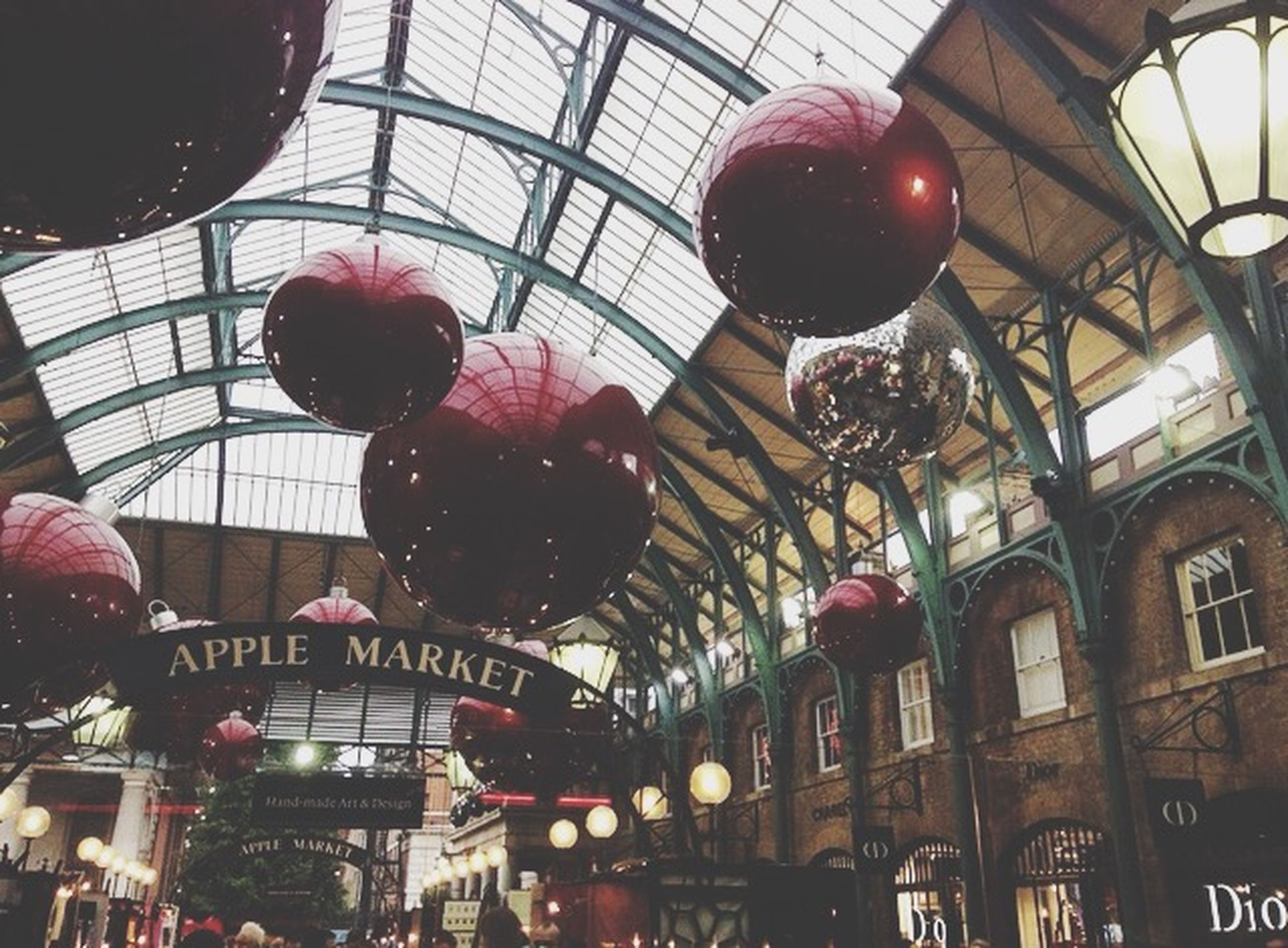indoors, architecture, low angle view, built structure, hanging, decoration, lighting equipment, illuminated, ceiling, window, lantern, red, building exterior, glass - material, christmas, christmas tree, christmas decoration, no people, chinese lantern, electric lamp
