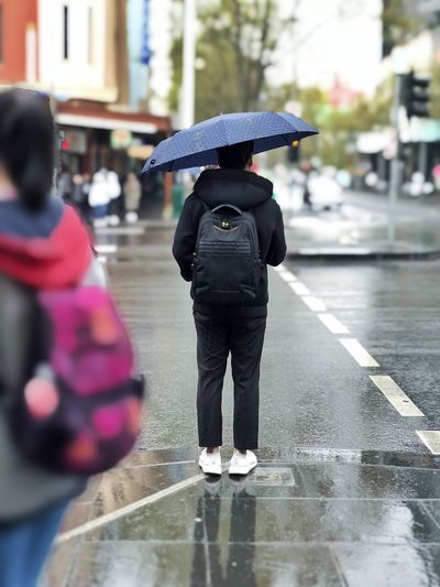 A man holding umbrella EyeEmNewHere Melbourne Wet Rain Water City Umbrella Street Protection Rainy Season Men Women Day Outdoors EyeEmNewHere