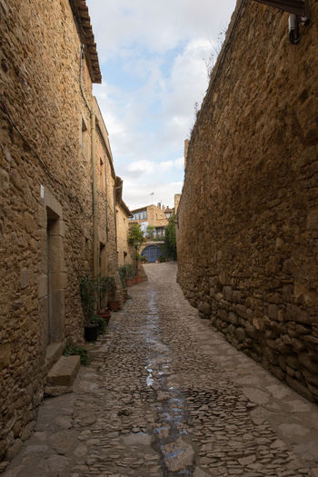 Catalonia Country Rural SPAIN Architecture Building Exterior Built Structure Cloud - Sky Cobblestone Day Girón Medieval No People Old Outdoors Peratallada Sky The Way Forward