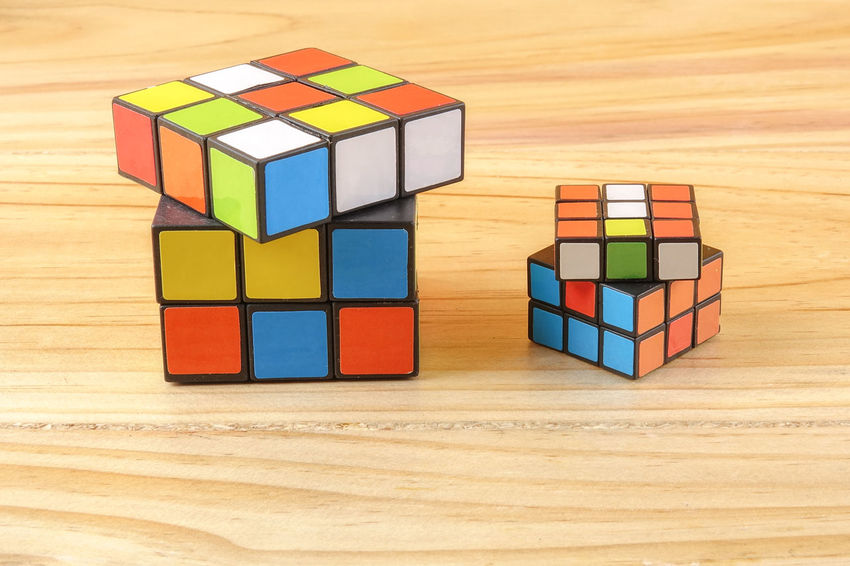RUBIK'S CUBE , CREATIVITY TOY Creativity Rubik Cube Block Childhood Choice Circle Close-up Creativity Cube Shape Design Geometric Shape Indoors  Intelligence Large Group Of Objects Multi Colored Puzzle  Rubik Shape Still Life Table Toy Toy Block Variation Wood - Material