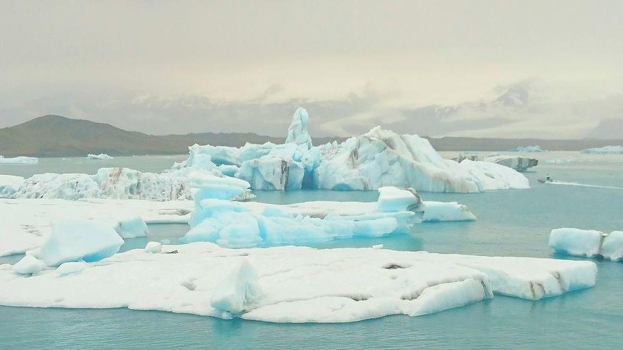 Scenic View Of Glacier Lagoon In Jokulsarlon Lake Against Sky