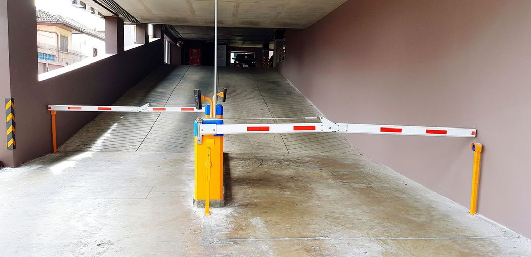 Security parking for building Security Parking Entrance Access Yellow Machine Barrier Identity Scan EyeEm Selects EyeEmNewHere Basement Industry Built Structure Road Construction Locked Entryway Barricade Entry Closed Traffic Cone