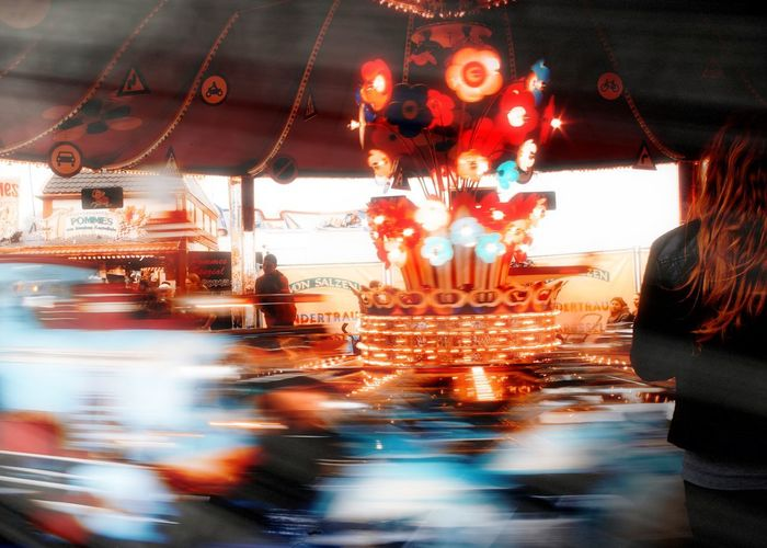 Blurred motion of illuminated carousel at amusement park