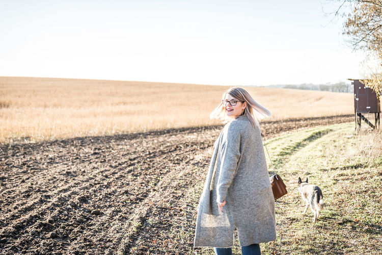 One Person Field Rural Scene Landscape Standing Adult Land Women Nature Day Sky Casual Clothing Young Adult Agriculture Plant Blond Hair Hair Copy Space Fashion Hairstyle Outdoors