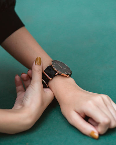 DW Wristwatch Product Shoot Hands Human Hand Watch Human Hand Women Females Close-up Checking The Time Instrument Of Time Time Wrist