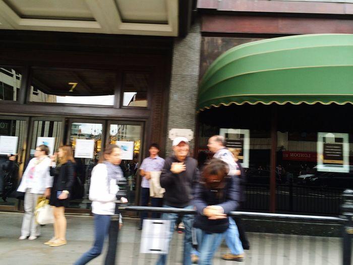 Group of people walking in building