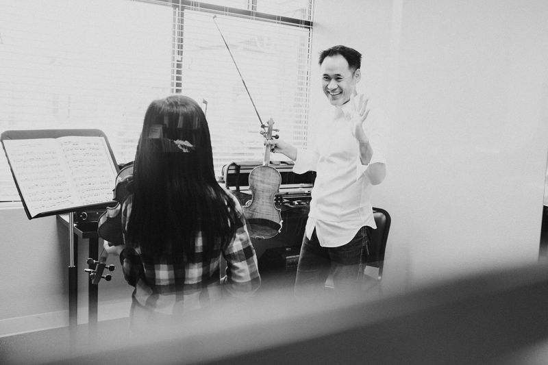 Enjoy The New Normal - violin class with Kevin. Genuine moment snapped through the door window. Real People Day Indoors  Documentary Photography Performal Wear Coregami Classical Music Violonist Violin Man At Work